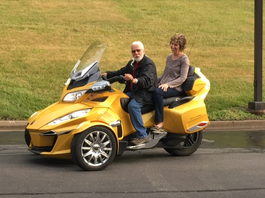 Chet taking Lisa for a spin on the Spyder